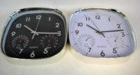 Levné nástěnné hodiny s barometrem